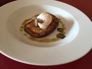 Poached duck egg on toasted brioche with truffle butter